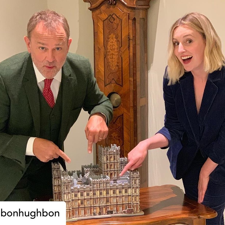 Hugh Bonneville and Laura Carmichael pointing at the Wrebbit 3D Downton Abbey 3D Puzzle at a press junket in Hamburg, Germany.